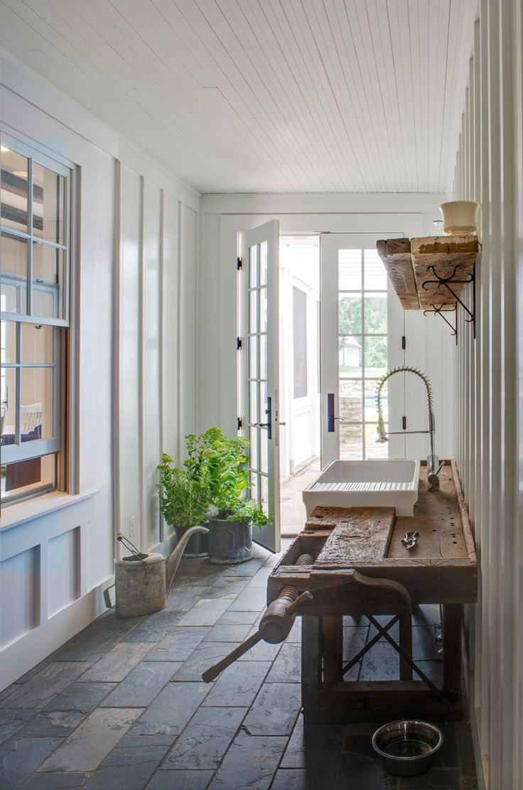 A proper garden is a must at the American farmhouse. Watering cans and clippers and garden clogs… and a new sink ensconced in something antique is a really great way to enter off of the garden if you can get it. (slate floor tile is nice size and work sink)