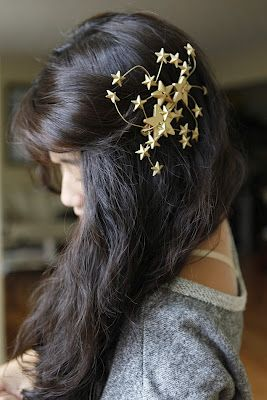 DIY Star Headband ... this would disappear into my own hair color but maybe if I found silver, blue or purple ones instead? Anyway it's a beautiful costume-y piece.