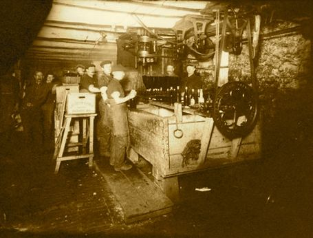 Workers making beer in the Grenville Brewery, Prescott, Grenville, Ontario, Canada