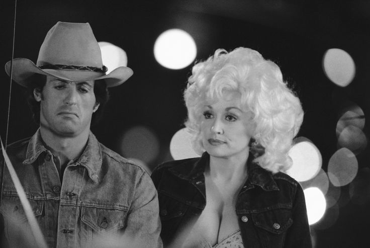 Sylvester Stallone as Nick Martinelli and Dolly Parton as Jake Farris and Ron Leibman as Freddie Ugo on the set Rhinestone directed by Bob Clark, photographed by Mario Suriani, 1983