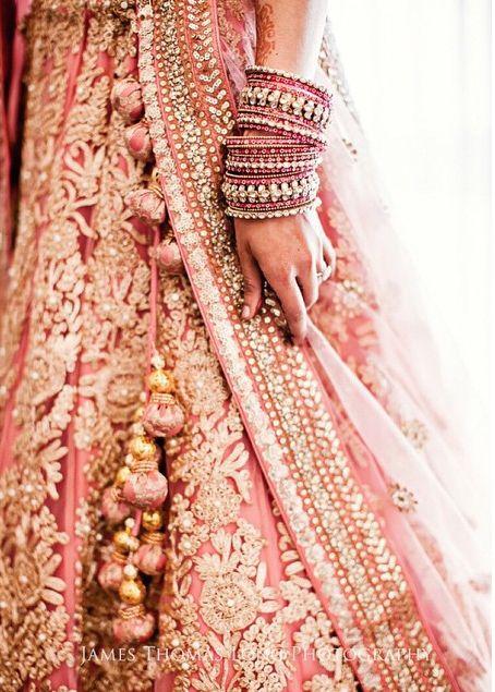 Lightpink Bridal Lehenga with tassels and matching bangles
