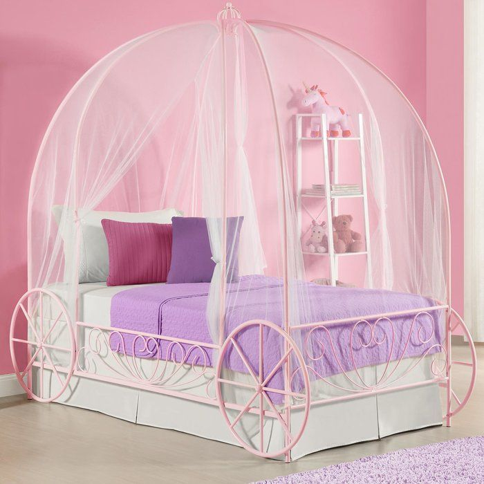 Create a wonderland in your princes's room with the unique metal twin carriage bed. Whimsical and scrolled lines in a white finish create a warm and classic look that will easily coordinate with all room decor. A crown on top of the frame adds to the charm and beauty. The low profile design and raised sides to allow your princess to safely climb in and out of bed without any help. Fit for your princess and the metal twin carriage bed is the perfect addition to her bedroom.