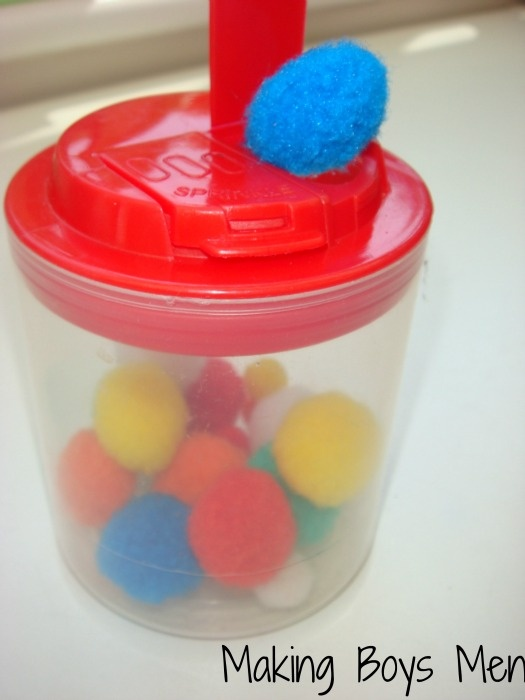 Pom Pom push: I saved a pot that had sugar sprinkles in it, the hole at the top is just large enough for little fingers to push pom poms into the pot.