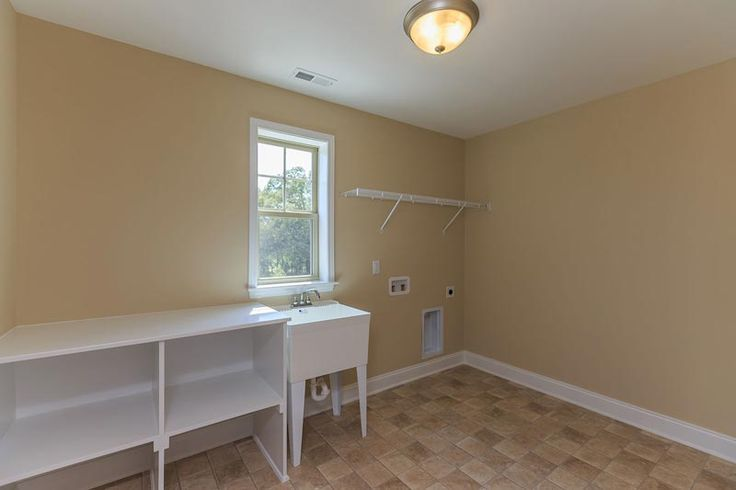 Second floor laundry room with utility sink in the Potter Craftsman KS