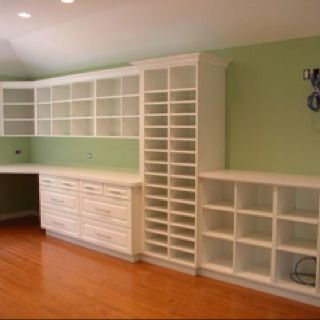 I wish these shelves were just waiting for me to fill up the spaces with my supplies.  And then I would place a large table in there and begin creating.