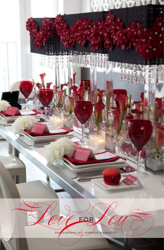 Valentines Day Wedding Ideas - this wedding table top design is stunning and chick. I love the mix of the black, white, pink & red. The modern touches like the decorated lamps, the square dishes, and the upright calla lilies. LOVE IT