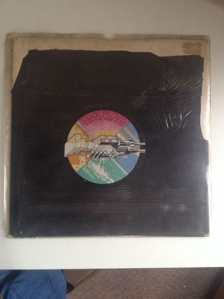 Pink Floyd - Wish You Were Here in the original bin-bag covering. I bought this when I was 16 years old from a second hand record shop in Barnstaple called Second Spin which sadly no longer exists...