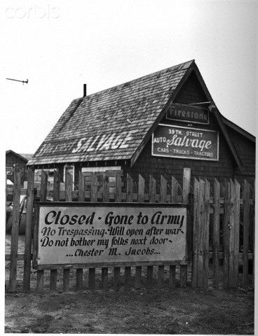 A sign on this Oklahoma City, Oklahoma, automobile salvage store proudly proclaims that the place is closed because the owner, one Chester M. Jacobs, has joined the Army for the duration of the war. November 1942.