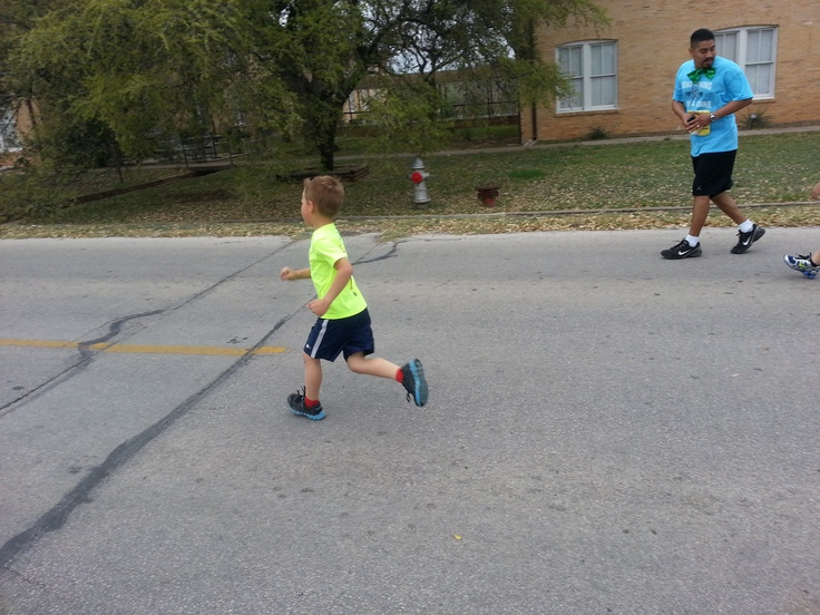 Anna's son Alexander running to the finish line during 2013 HFTC 5K - Jo Hewitt (of Team Jo) is his kindergarten teacher