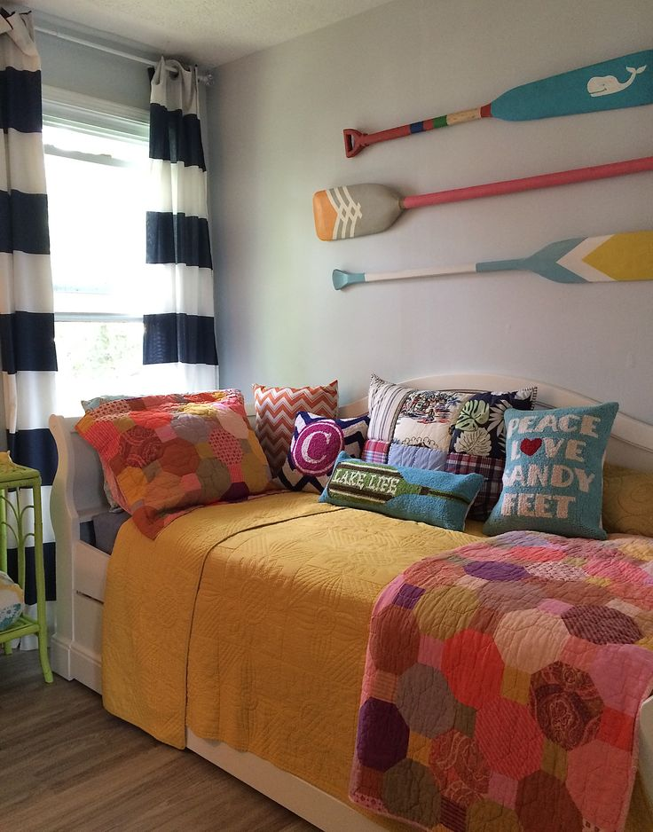 Peace, Love and Sandy Feet! Think outside the box and create a colorful nautical inspired teen room with a mix and match approach. Bright bedding, nautical navy and white striped curtains and graphic painted wooden oars all from HomeGoods. Happy By Design Sponsored Post