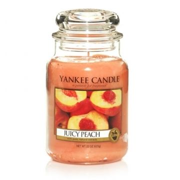 Yankee Candle Juicy Peach : Practically dripping with the mouth-watering scent of luscious, crisp orchard peaches.