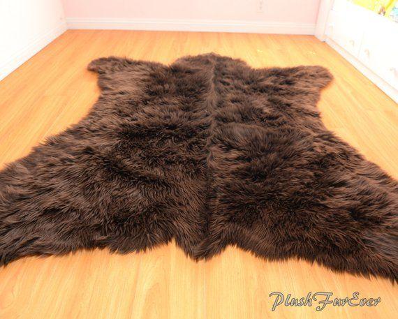 Description Dimensions 5 X 6 Feet Color Brown Shaggy Shape Realistic Bear Shape Material Premium Faux Fur Nonslip Faux Fur Rug Faux Fur Area Rug Bear Rug