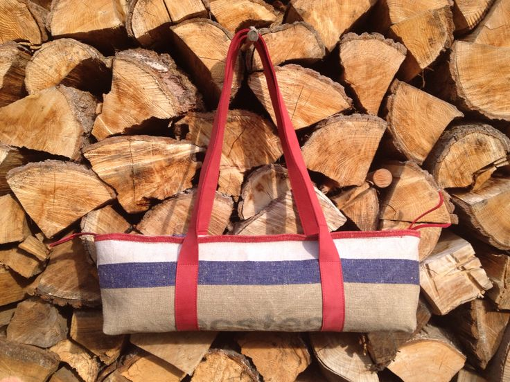 Shoulderbag, made of the old Dutch postbag and red leather, with 2 zipped pockets inside.