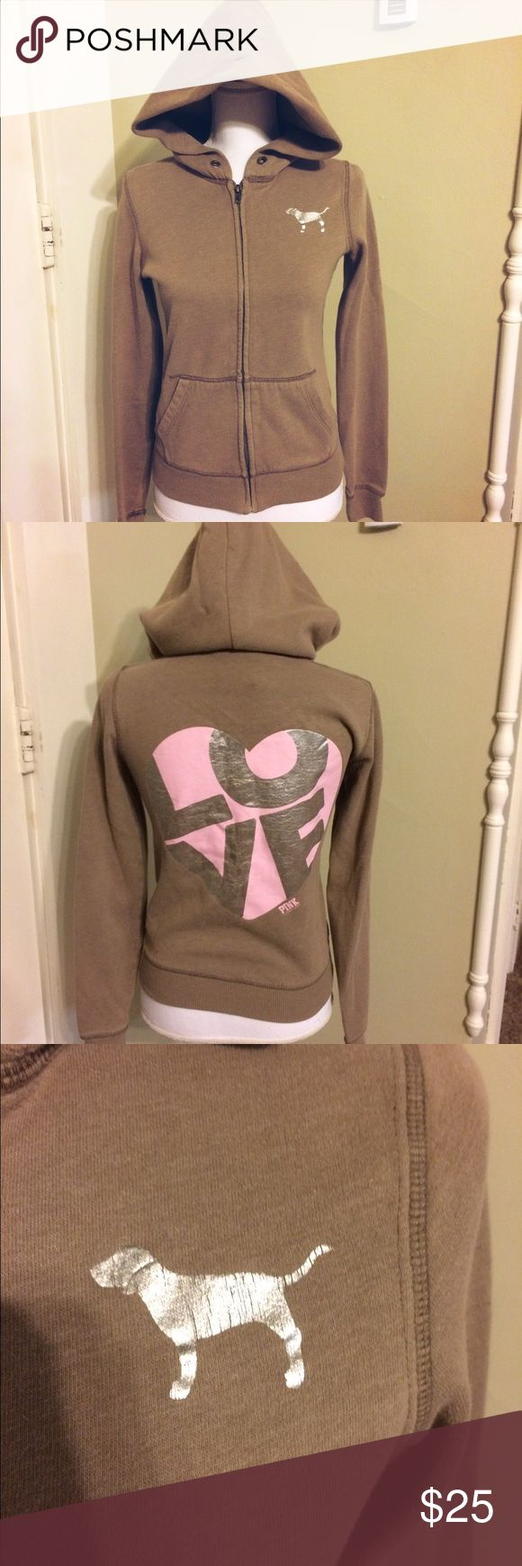 "PINK Victoria's Secret light brown zip up hoodie PINK Victoria's Secret light brown zip up hoodie with silver PINK dog & pink ""love"" on the back in a heart. Size x-small, approximate flat measurements: length 22"" width 16"". PINK Victoria's Secret Tops Sweatshirts & Hoodies"