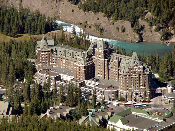 2.146 The Banff Springs Hotel is a luxury hotel that was built during the 19th century as one of Canada's grand railway hotels, being constructed in Scottish Baronial style and located in Banff National Park, Alberta, Canada. The hotel was opened to the public on June 1, 1888. Presently, The Fairmont Banff Springs resort hotel is owned by OMERS and operated by Fairmont Hotels and Resorts of Toronto. Banff Springs Hotel is situated at an altitude of 1414 m. The original bu...