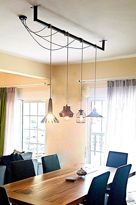 Very creative way to guide lighting on center of table with the use of one junction box! etsy