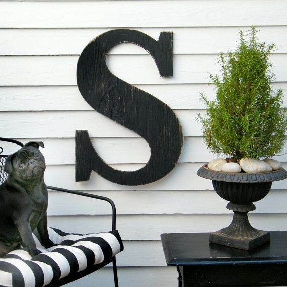 Front Porch... Love the letter, and the rosemary pot with stones.