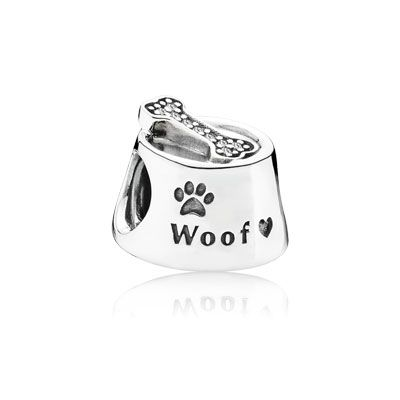 Complete with paw prints and a bone encrusted with sparkling stones, this cute sterling silver portrayal of a dog's feeding bowl will add a whimsical touch to any bracelet. #PANDORA #PANDORAcharm