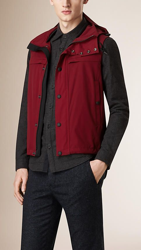 Burberry Dark Crimson Showerproof Technical Gilet - A showerproof gilet in a lightweight technical fabric. The slim-fit design features a drawcord detachable hood, and fastens with a concealed zip and press-stud closure. Discover the men's outerwear collection at Burberry.com