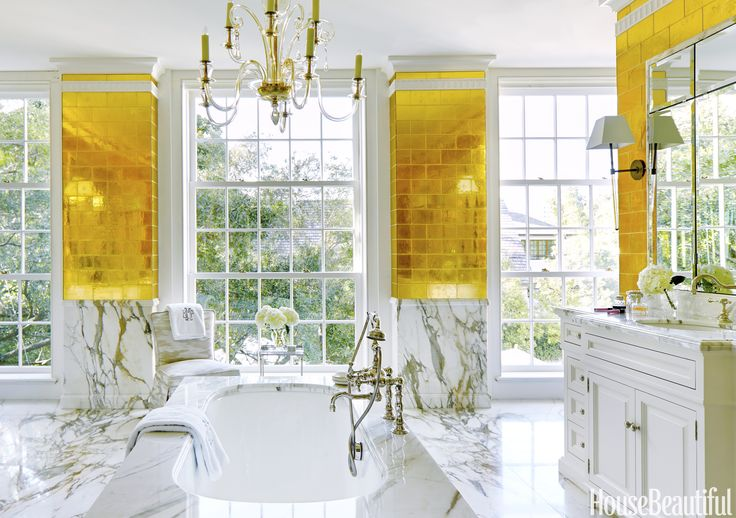 Gold Leaf  Designer Bailey McCarthy finally got a chance to use Davlin gold-leaf glass tiles from Ann Sacks in her newly enlarged master bathroom.