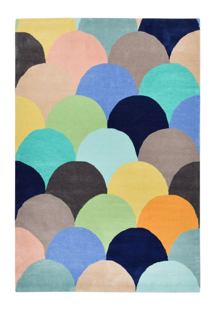 $499 160 x 230 The Macaroons Sky Rug features a multi-colour scalloped pattern in shades of blue, green, peach
