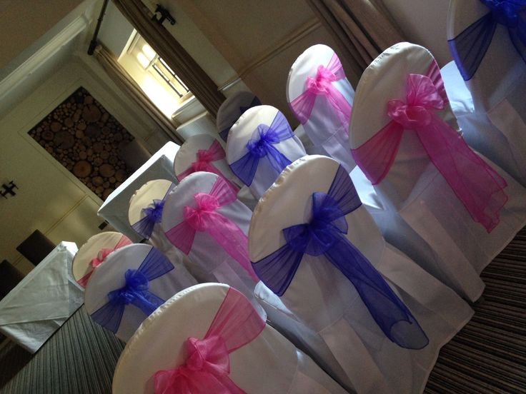 Chair covers with royal blue and bubblegum pink sashes