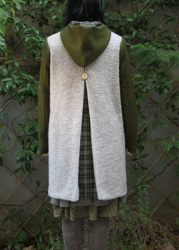 """Off white wool coat with olive green sleeves and  a pleat on the back from where emerges  checkered olive green fabric, by """"EatingTheGoober"""""""