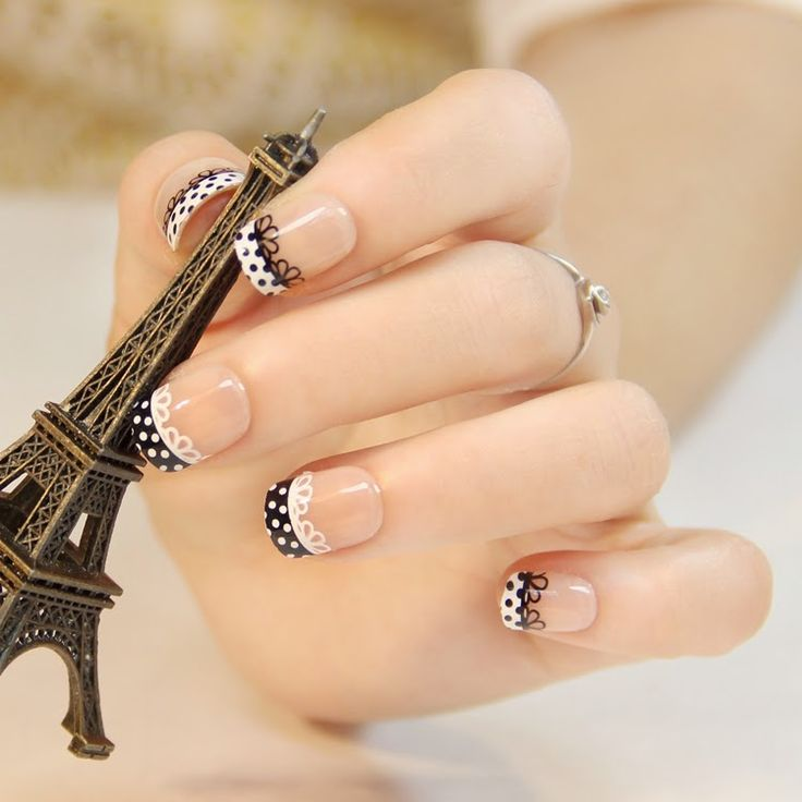 Black and white polka dot and lace French manicure.