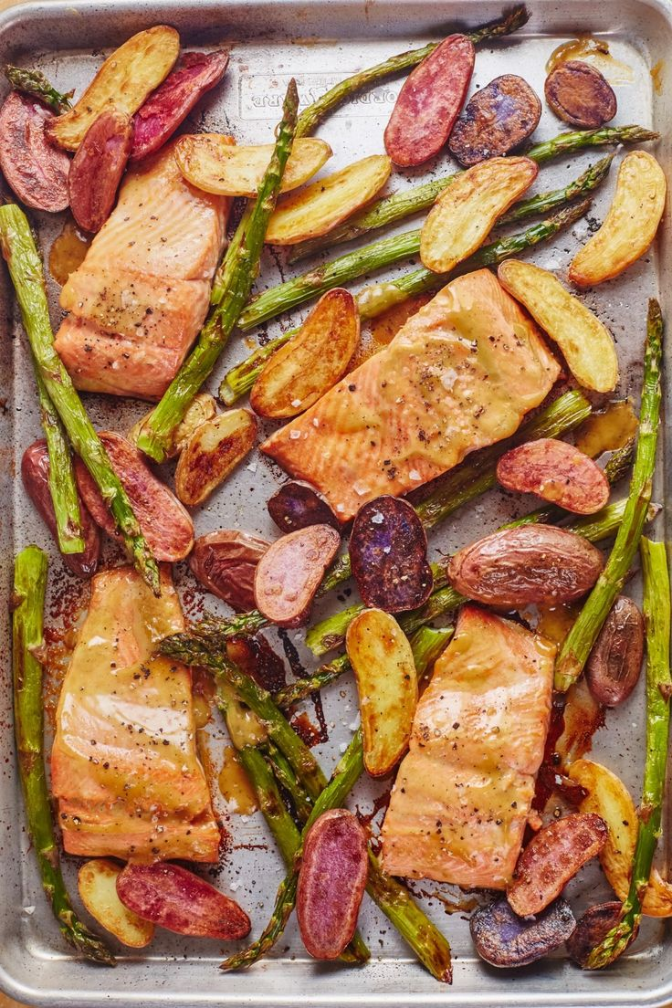 Quick and Easy Dinners: Sheet Pan Mustard Maple Salmon with Potatoes and Asparagus Recipe. Looking for ideas for healthy meals to make on weeknights? This SIMPLE fish dinner is the answer! Throw some veggies and filets on a pan for this satisfying one pan meal.