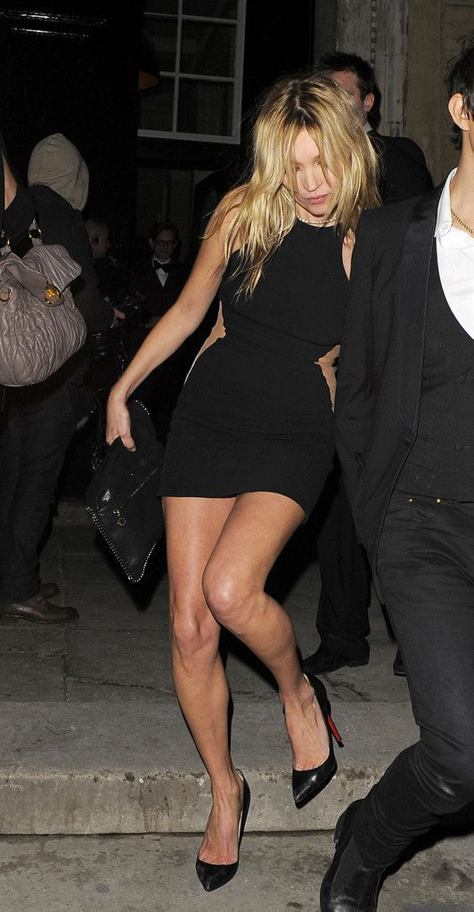 Kate Moss looks a bit worse for wear as she leaves Stella McCartney's 2012 London Fashion Week party with husband Jamie Hince.