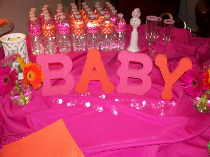 Hot pink and orange baby shower  www.loveisinbloomevents.com