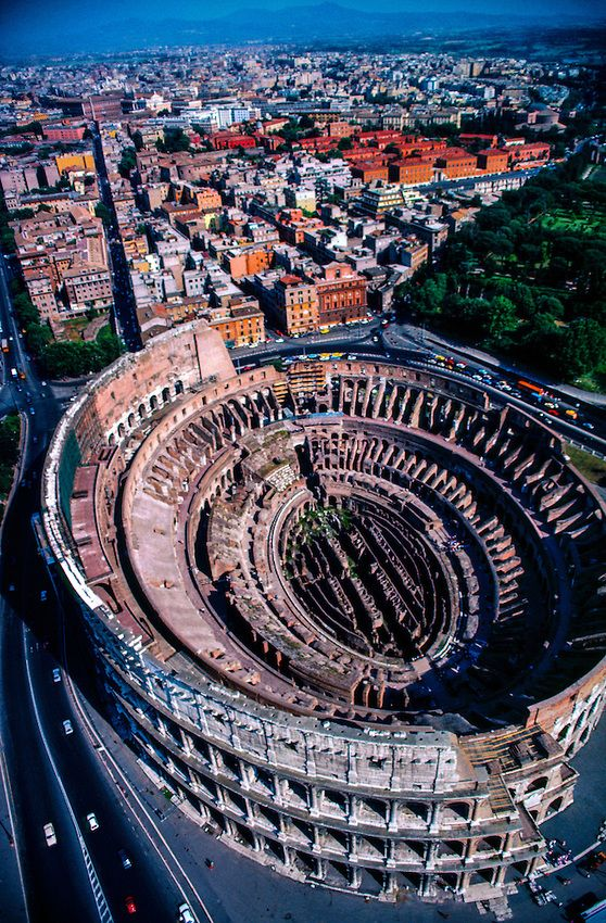 Aerial view of the Colosseum, Rome, Italy. Over 1000 years more than 1 million people were killed and slaughtered in the Coliseum. The church condemned the place but when they needed money they re-opened it to gladiators for 300 more years.