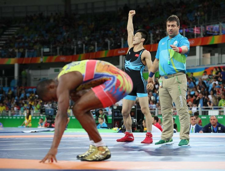 Best images from Aug. 14 at the Rio Olympics:      Lumin Wang of China celebrates after defeating Andres Roberto Montano Arroyo of Ecuador during the men's greco roman 59g kg wrestling 1/8 finals in the Rio 2016 Summer Olympic Games at Carioca Arena 2.