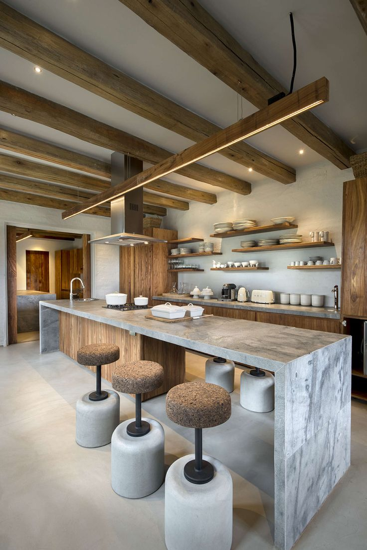 Natural Textures Abound In The Kitchen With Its Leathered Granite Tops And  Cork And Cement Bar Stools From Wiid Design. The Overhead Strip Lighting Is  By ... Part 69