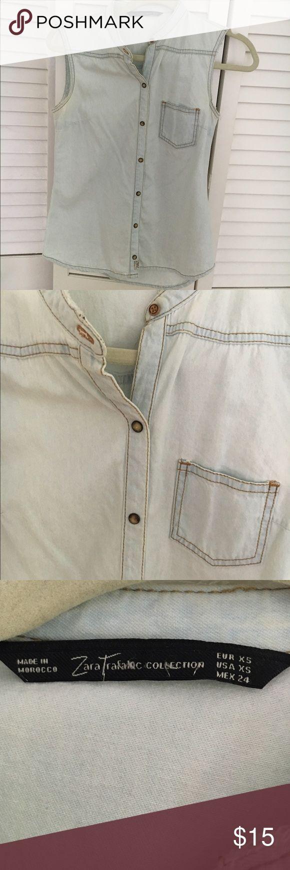 Zara sleeveless denim shirt Cute sleeveless light denim shirt. Purchased from Zara. Worn lightly. Really cute worn buttoned or unbuttoned over a dress or tank. Zara Tops Button Down Shirts
