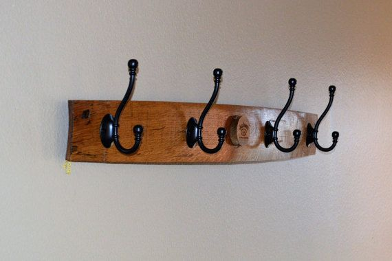 This listing is for a Whiskey Barrel Stave Coat Rack / Hat Rack Made From a Used Jack Daniels Oak Whiskey Barrel. These coat racks / hat racks are made from a used whiskey barrel bung hole stave from authentic Jack Daniels charred oak whiskey barrels used for aging whiskey. The