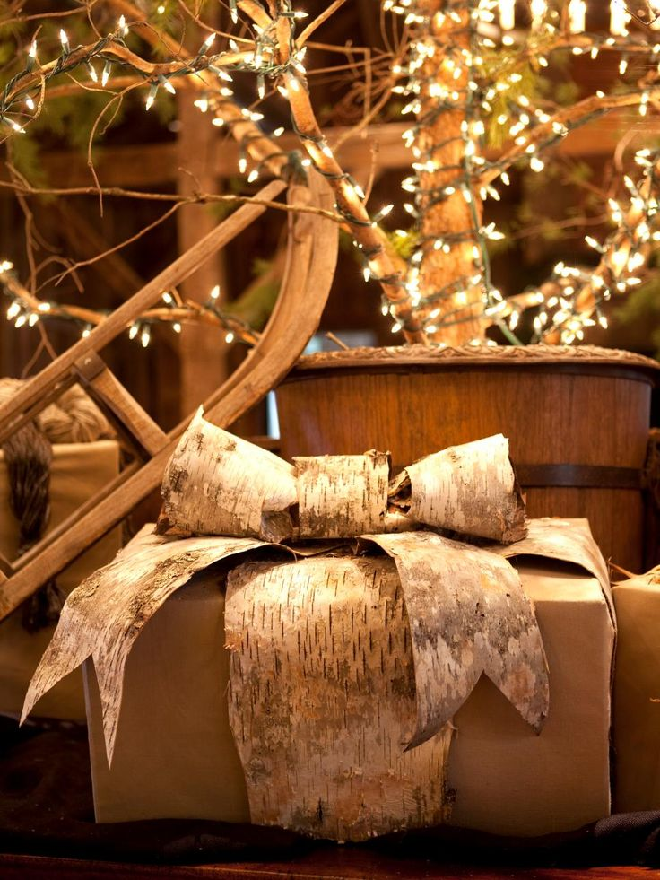 This muslin and birch bark-wrapped gift is almost too pretty to open! Get more mountain-inspired Christmas decorating ideas here >> http://www.diynetwork.com/how-to/make-and-decorate/entertaining/rustic-yet-elegant-mountain-inspired-christmas-decorating-ideas-pictures?soc=pinterest
