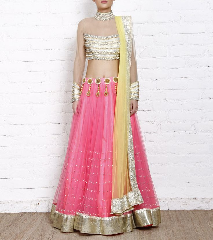 Yellow and pink #netlehenga set featuring a crystal and pearl studded choli in band neck style