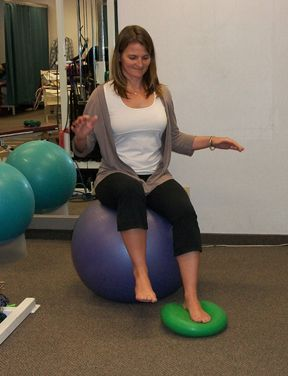 Seated Balance Exercise – non-weight bearing exercise, good for early-stage rehab. Improves proprioception, balance and strength. For added difficulty, close your eyes.
