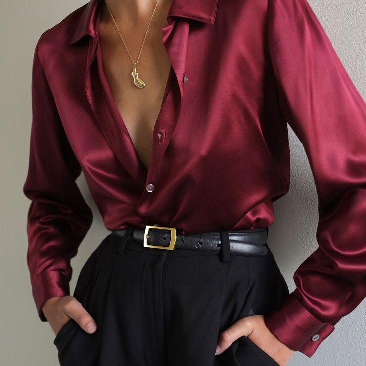 Burgundy blouse and black trousers black belt Foll…