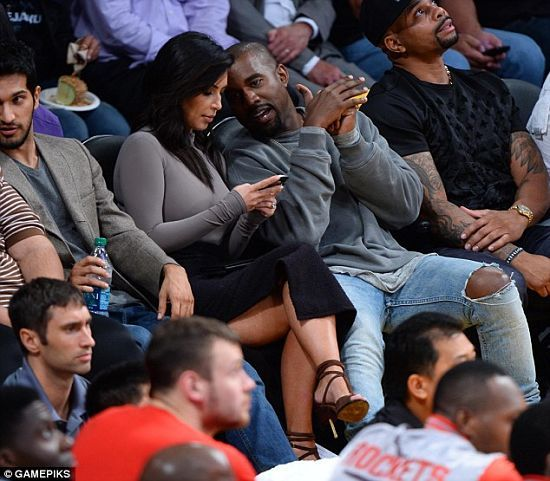 Kim Kardashian and Kanye West at Lakers vs Rockets Game- http://getmybuzzup.com/wp-content/uploads/2014/10/383426-thumb.jpg- http://getmybuzzup.com/kim-kardashian-and-kanye-west/- By BeyondGossip Staff Kim Kardashian and Kanye West on Tuesday night attended the basketball game between LA Lakers and Houston Rockets at the Staples Center in Los Angeles. Kim was surprisingly all covered up on top, as she was not flaunting her famous cleavage. The 34-year-old reality star...- #Ka