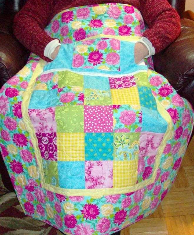 Patchwork Lovie Lap Quilt with Pockets.  Great gift for Mom or Grandma.  Pockets are lined in flannel as well as the back of the quilt.  To purchase -…