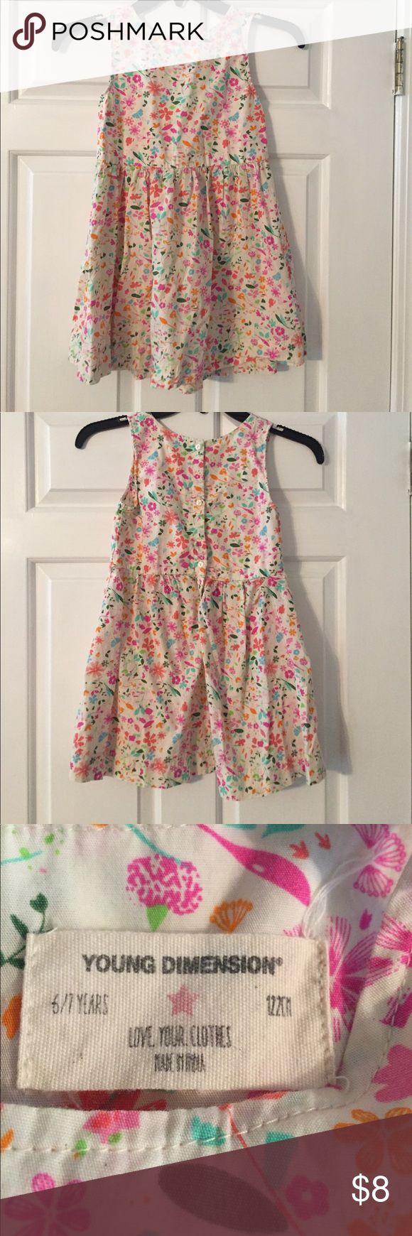 Young dimensions dress Pretty floral dress.  Barely worn.  No rips or stains and smoke free home.  Size 4-6 years old. This stores sizes run on smaller sizing so petite 6 year old or a regular size 4/5.  From primark dept store check website for sizing. young dimensions Dresses Casual