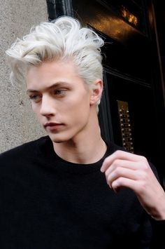 Dane's hair = like this but with a few tufts of his original black at the sides