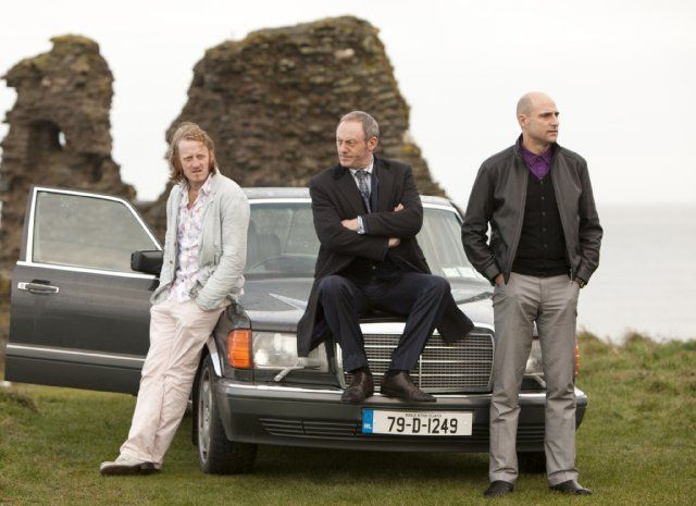 Still of Liam Cunningham, Mark Strong and David Wilmot in The Guard