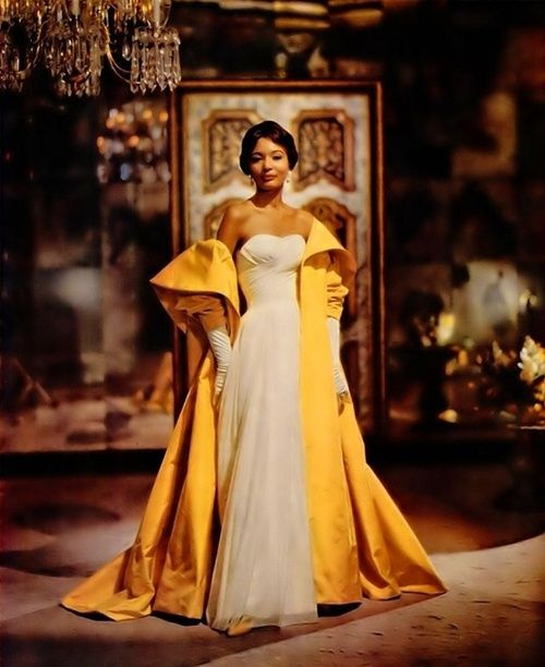1950s evening gown. Yeah. Forget the gown; that overcoat is stunning!!