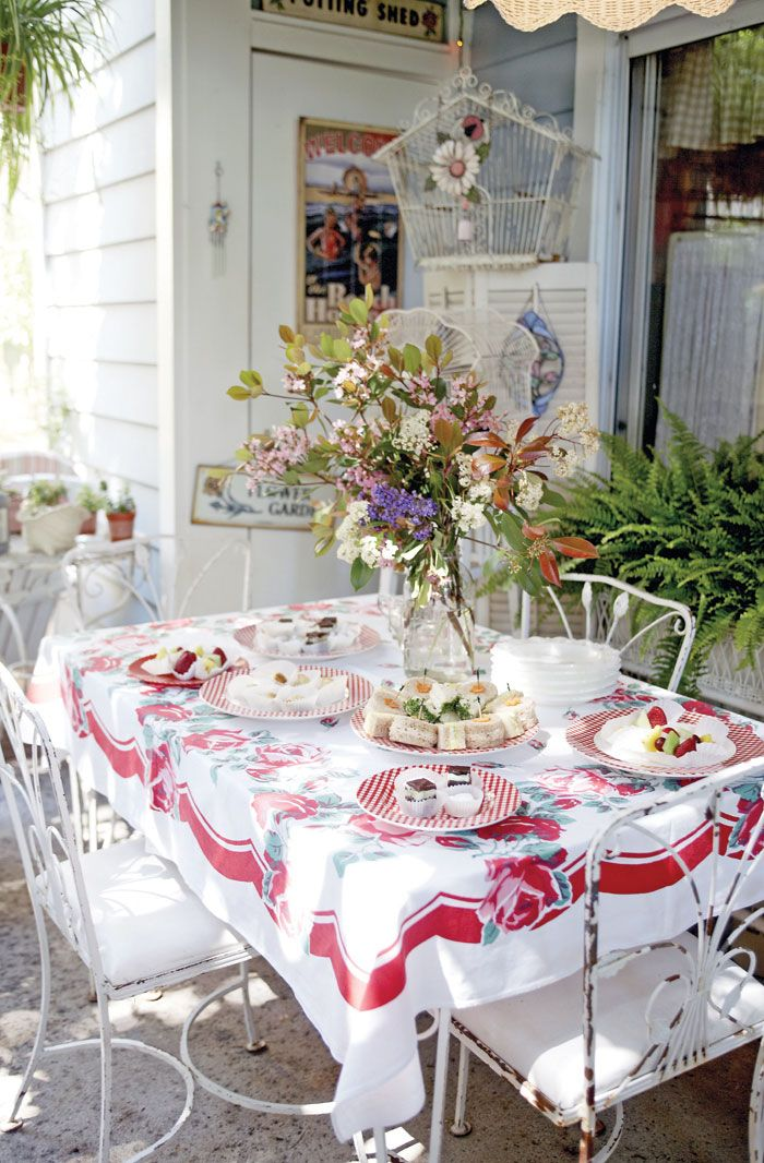 Romantic RETRO - Begin with a vintage tablecloth. Put it over a white or lace tablecloth.  Include cloth napkins, carafes for garden cuttings, buckets, old watering cans, thermos, enamelware coffee pots, Depression glass pieces, vintage jars, and cans. Use vintage cream and sugar bowls to hold tea lights. Mix-match checks, polka dots, stripes, and flower patterns IF they all share a specific color. Photo by Jamiee Itagaki.