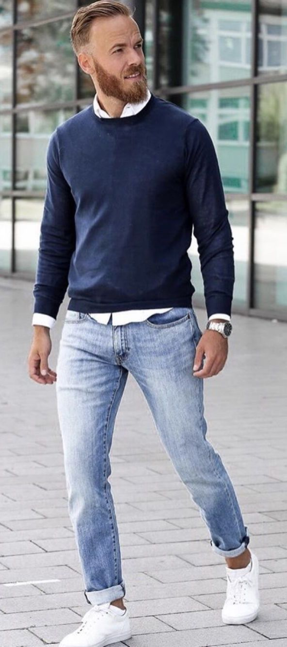 c7bc8cfe0a6f Fall business casual inspiration with a navy sweatshirt white button up  shirt silver banded watch light wash denim white sneakers. mode…