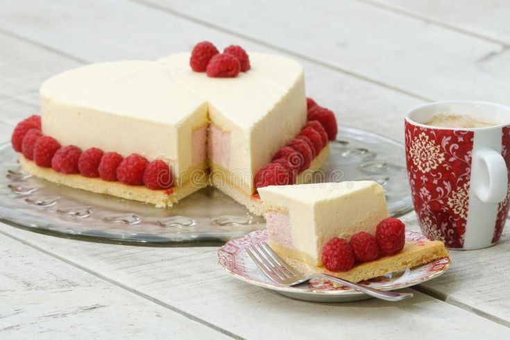 Photo about Romantic heart shaped mother's day cake with raspberries, Setting with cut piece of cake and cup of coffee on a white table. Image of cream, mother, cake - 19430893