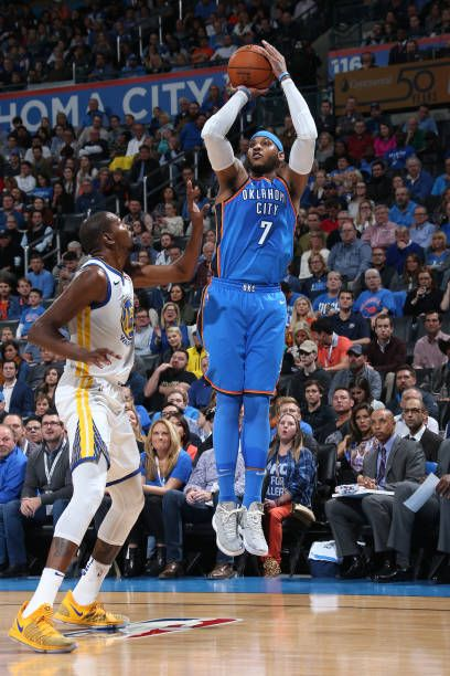 Carmelo Anthony of the Oklahoma City Thunder shoots the ball against the Golden State Warriors on November 22 2017 at Chesapeake Energy Arena in...
